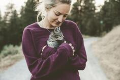 Young lady and kitten being loved